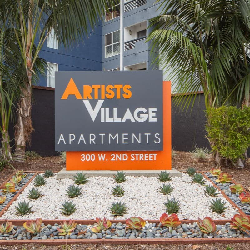 Artist Village Apartments Sign with landscaping