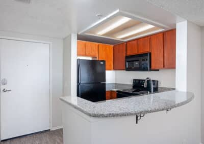 Kitchen with appliances, countertops, and wood cabinets