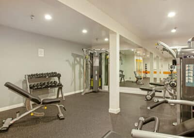Artists Village Apartments gym with workout equipment