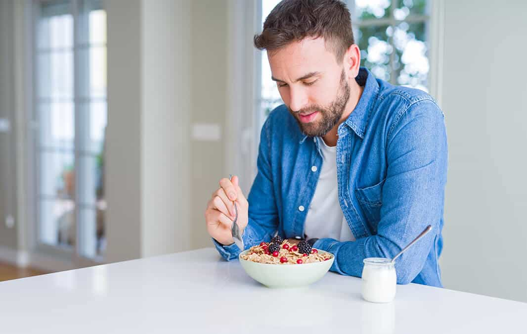 Man eating healthy food at the table