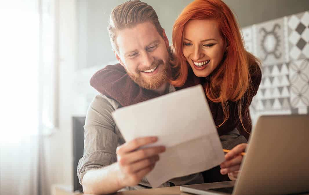 Couple paying rent online